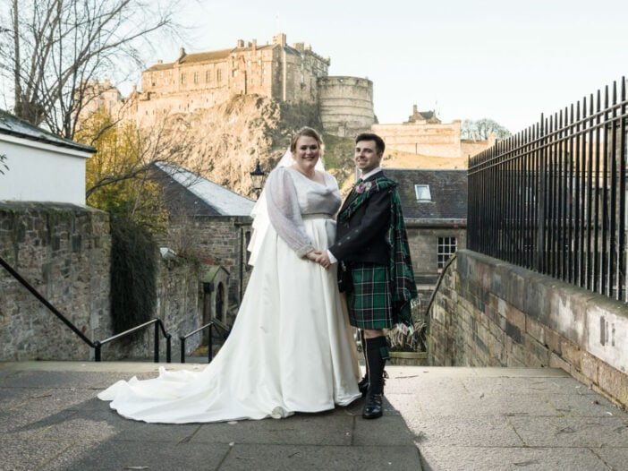 bride and groom photographed at The Vennel with Edinburgh Castle in the distance
