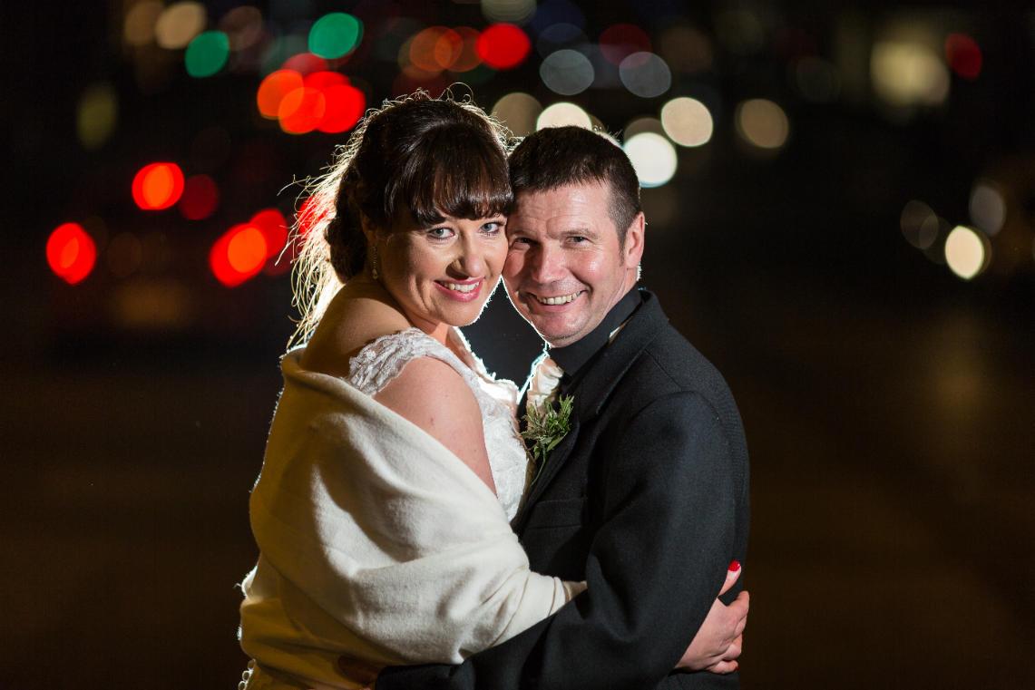 newlyweds backlit photo at night on Waterloo Place