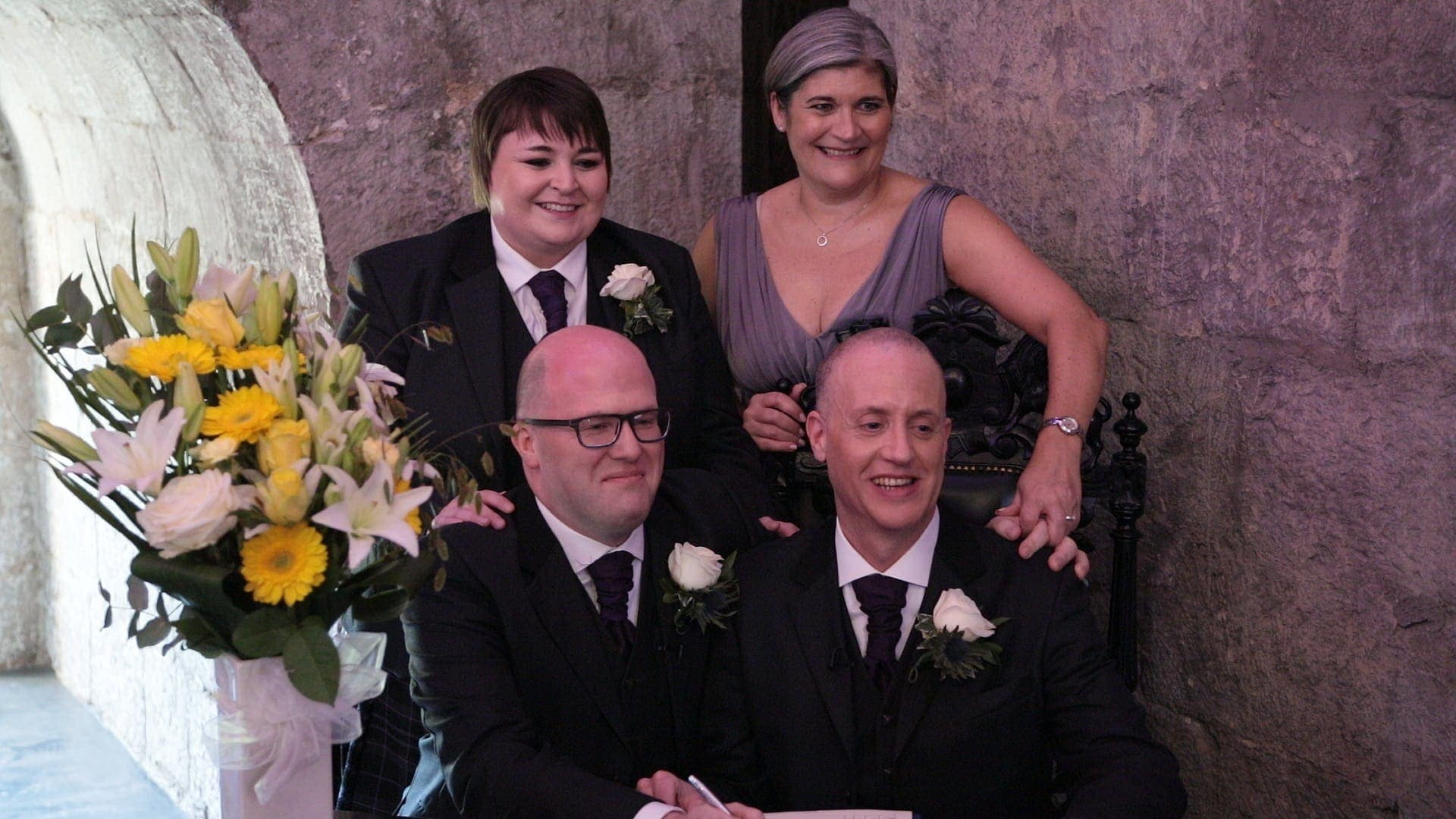 Borthwick Castle Wedding Videographer - Newly-weds and witnesses signing the marriage schedule