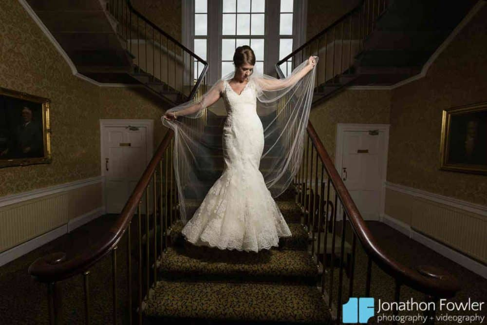 Bride posed photo on staircase at Balbirnie House
