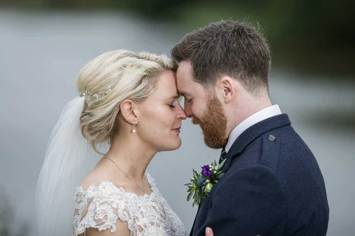 Newlyweds touching heads with their eyes closed