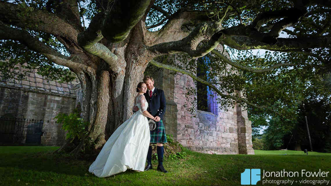 newly-weds night time photo outside Dunlass Collegiate church