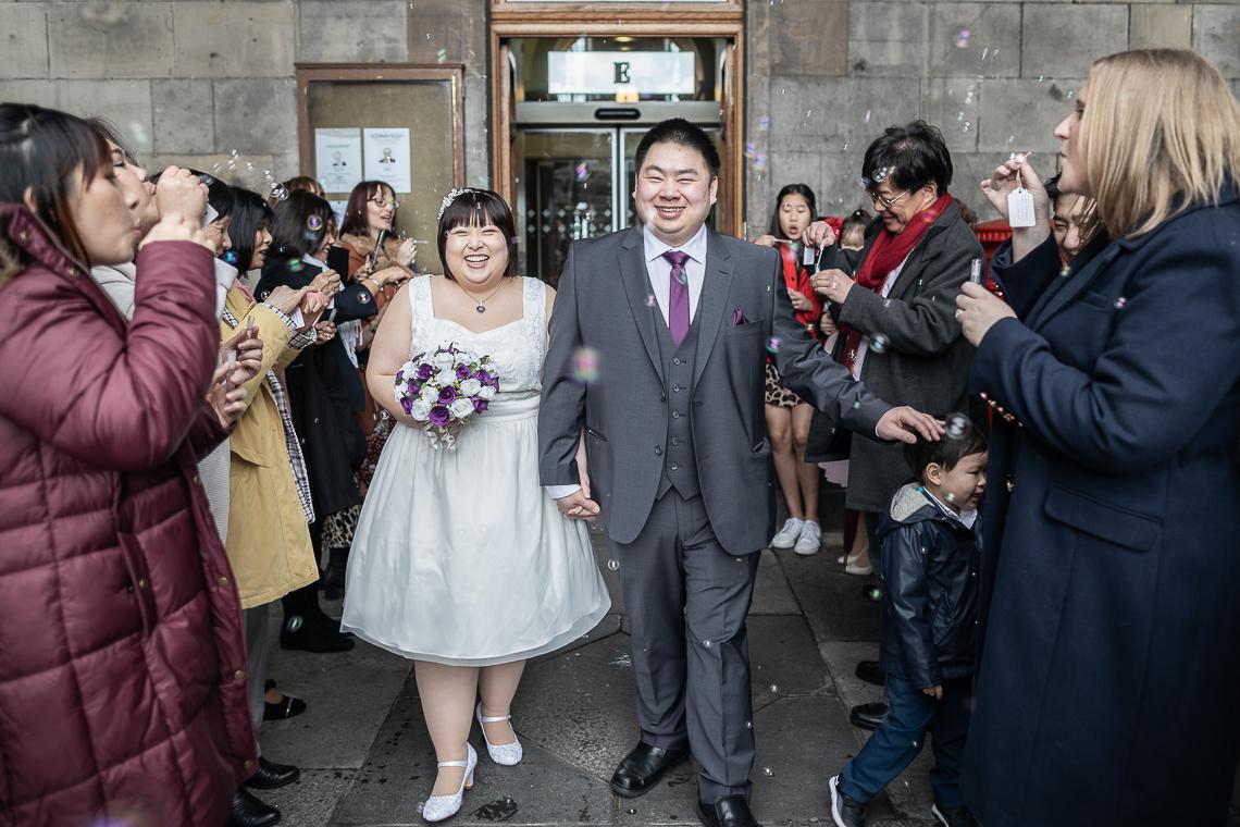 Edinburgh City Chambers Wedding - Chowping and David walk through the bubble tunnel