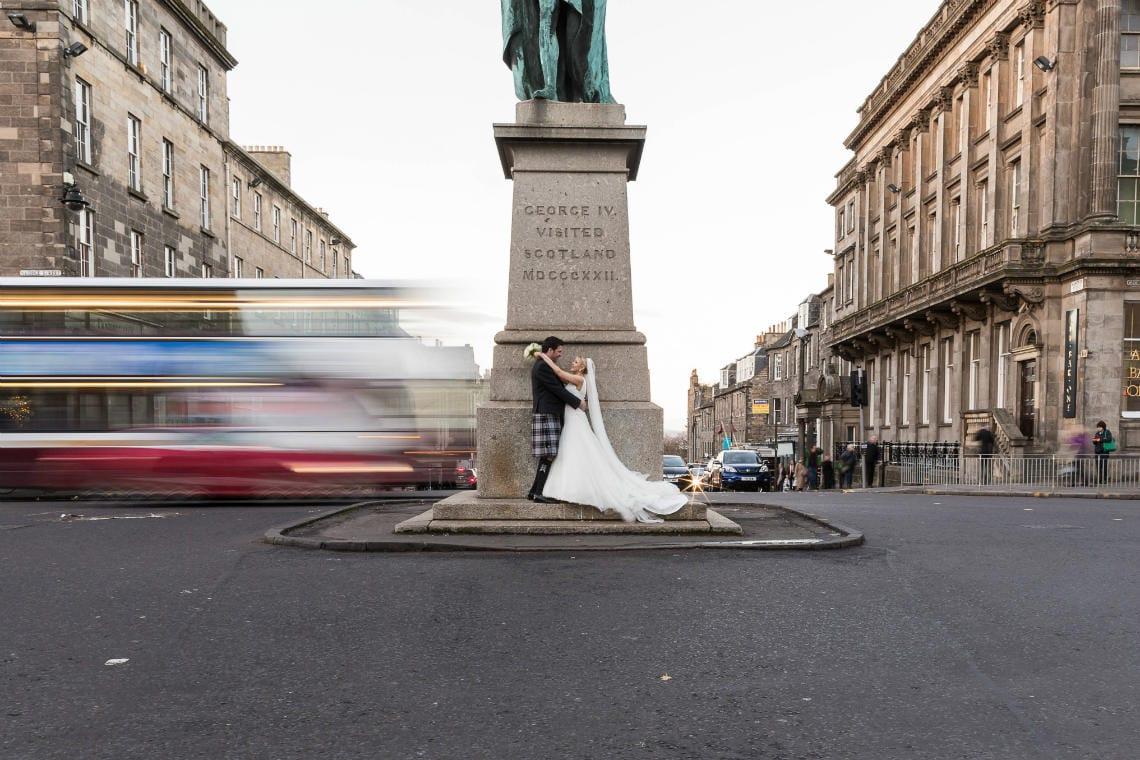 Edinburgh George Hotel Wedding newly-weds slow shutter photo on George Street Edinburgh