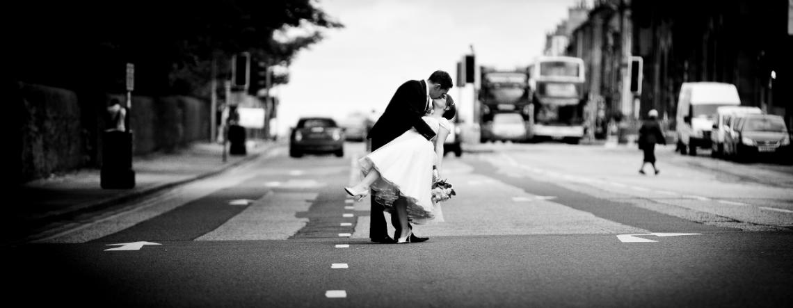 George Hotel Wedding Photographer bride and groom embrace on Queen Street
