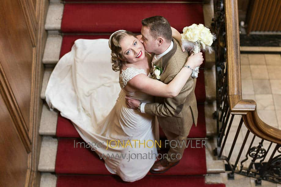 civil marriage ceremony at Lothian Chambers newlyweds on red carpet staircase