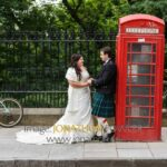 Nick and Michelle pose by a red telephone box