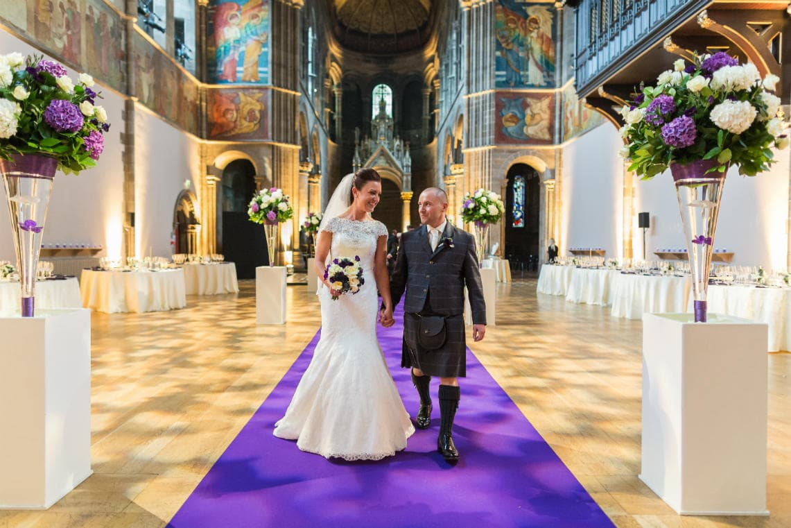 newlyweds walking up the aisle