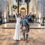 Mansfield Traquair wedding photographers - Gemma and Darren celebrate walking up the aisle