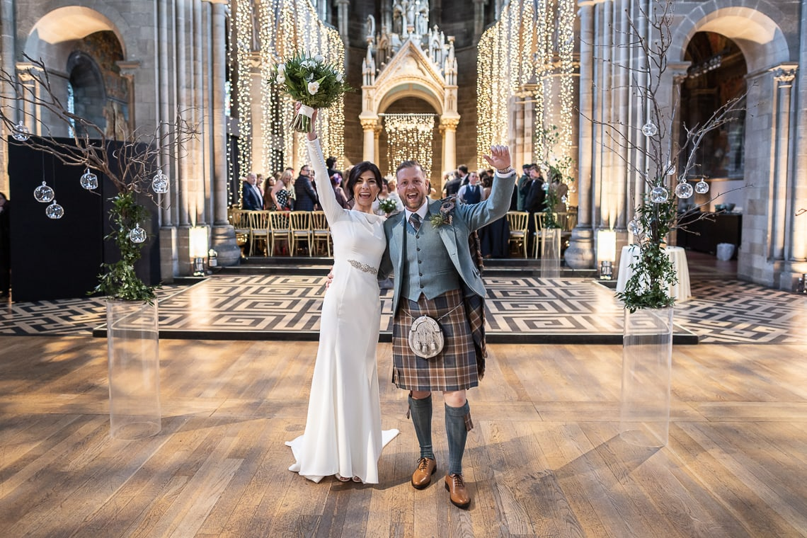 Mansfield Traquair wedding photographers - Gemma and Darren celebrate walking up the aisle
