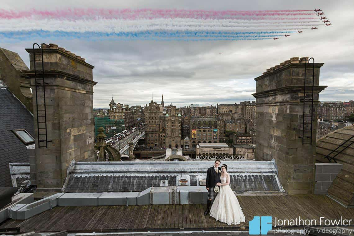 The Most Popular Wedding Photo Of The Year - Balmoral Hotel newly-weds on roof with Red Arrows flypast