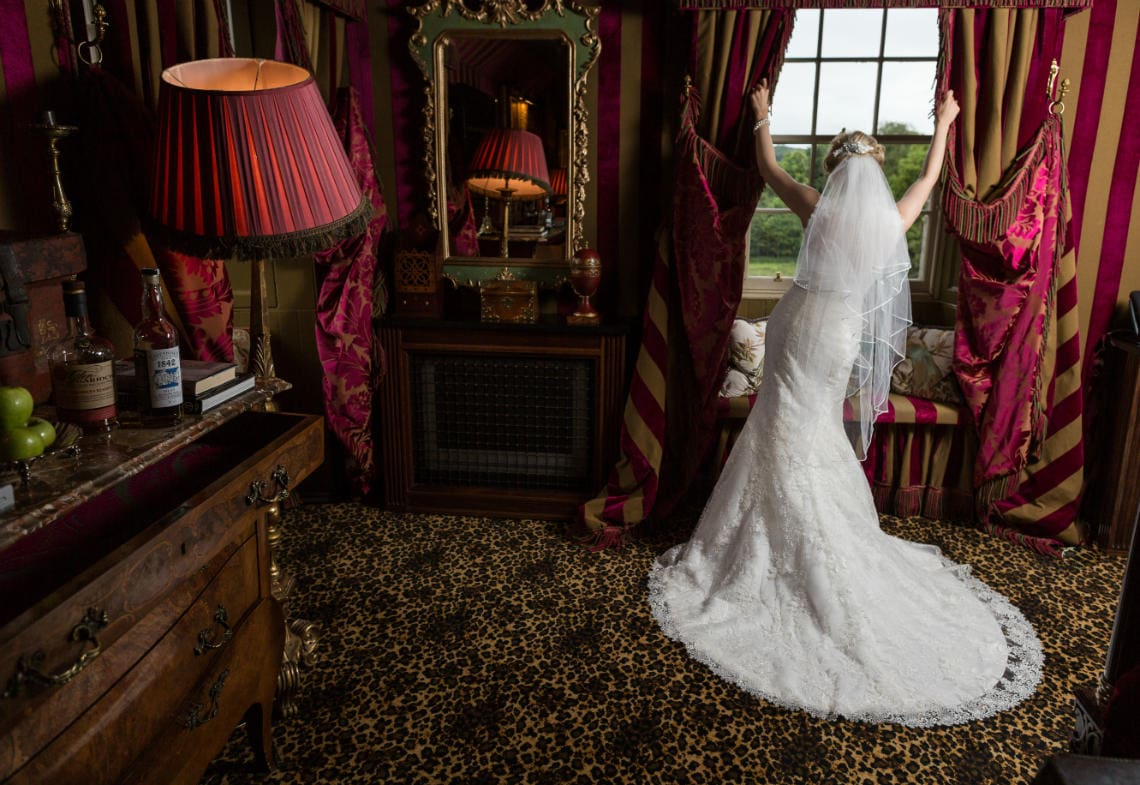 Prestonfield House wedding full-length bridal pose in front of the window in her bedroom suite