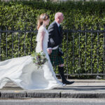 Royal College Of Physicians Edinburgh Wedding - Gill and Iain walking along Queen Street