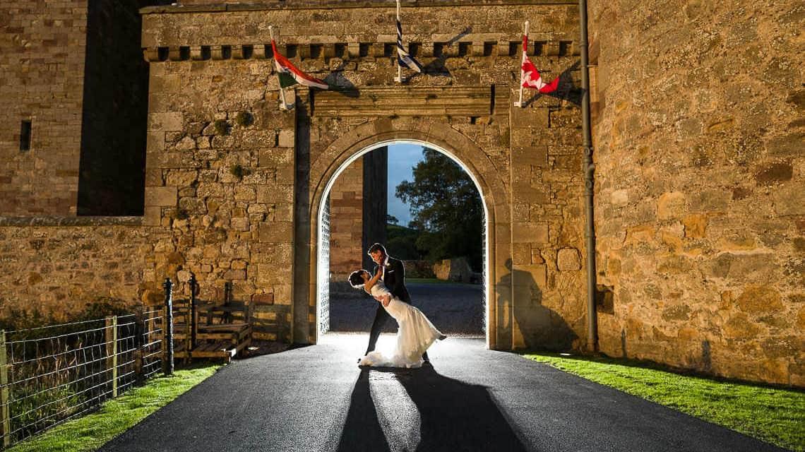 Scottish wedding photographers in Edinburgh videographers Lothian filmmakers Borders - newly-weds at Borthwick Castle