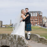 newlyweds embrace on Swilken Bridge for St Andrews wedding photographer