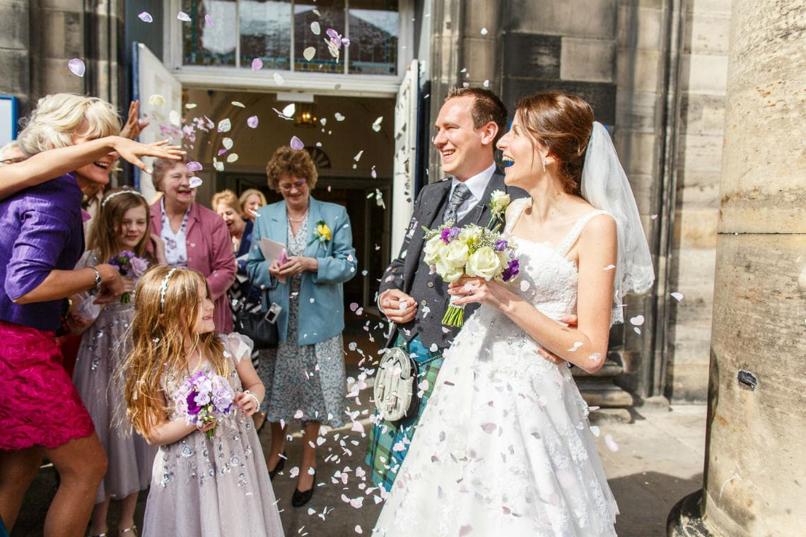 newlyweds confetti shower outside St Andrew's and St George's West Church of Scotland