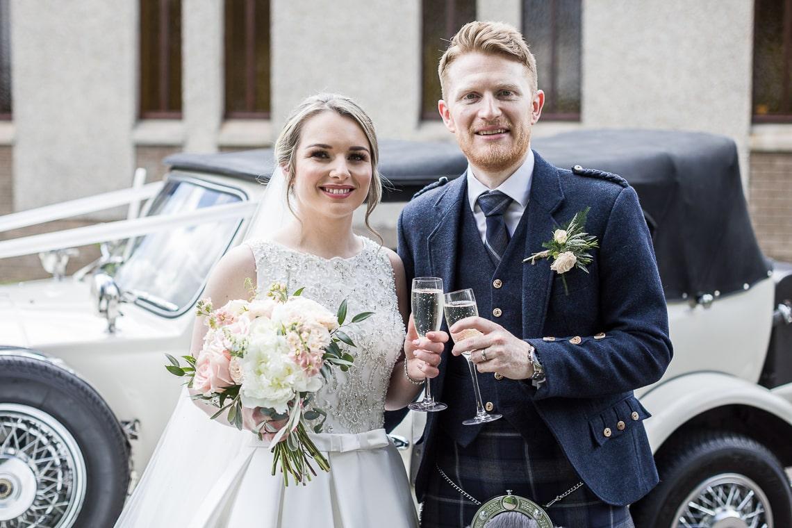 Newlyweds outside the church