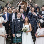 Group confetti photo outside St Mary's Cathedral Edinburgh