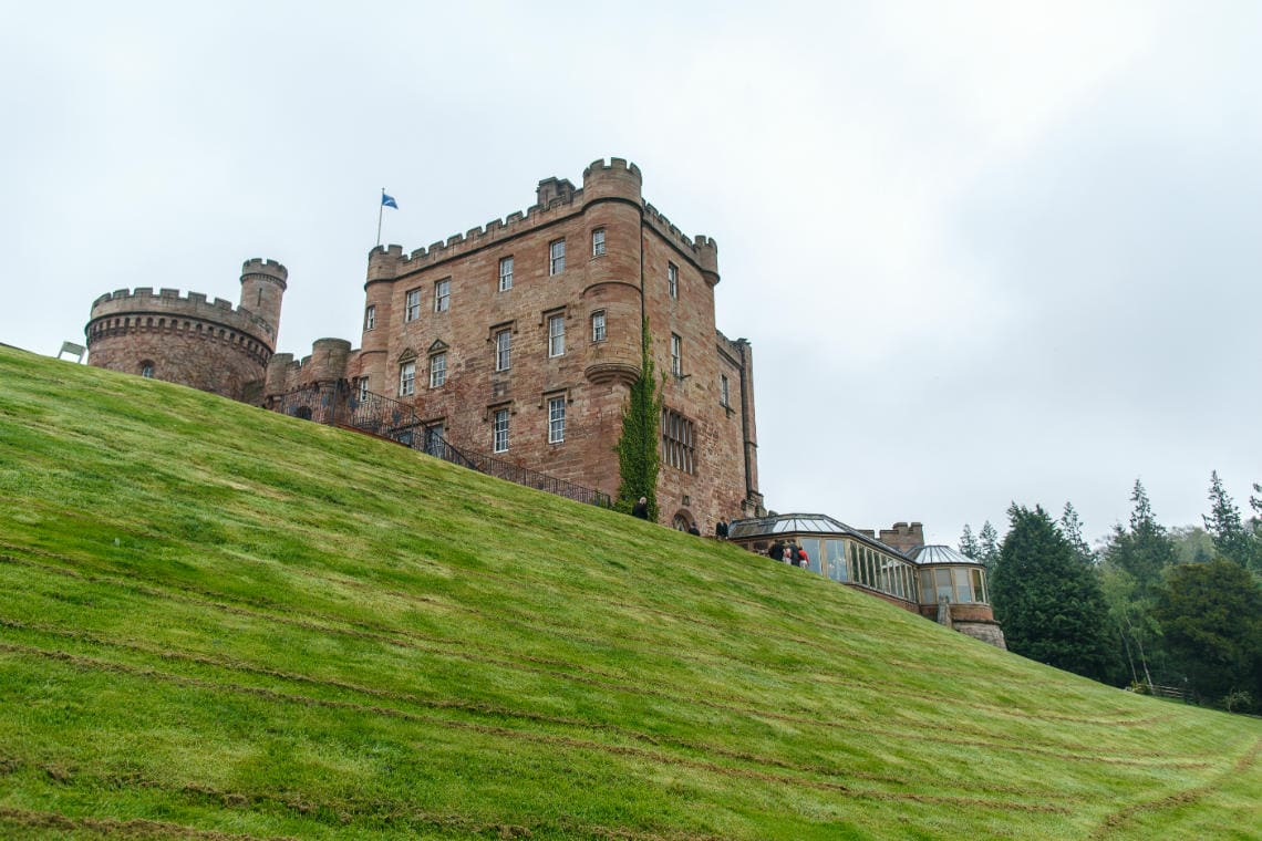 castle exterior view from the sloping lawn