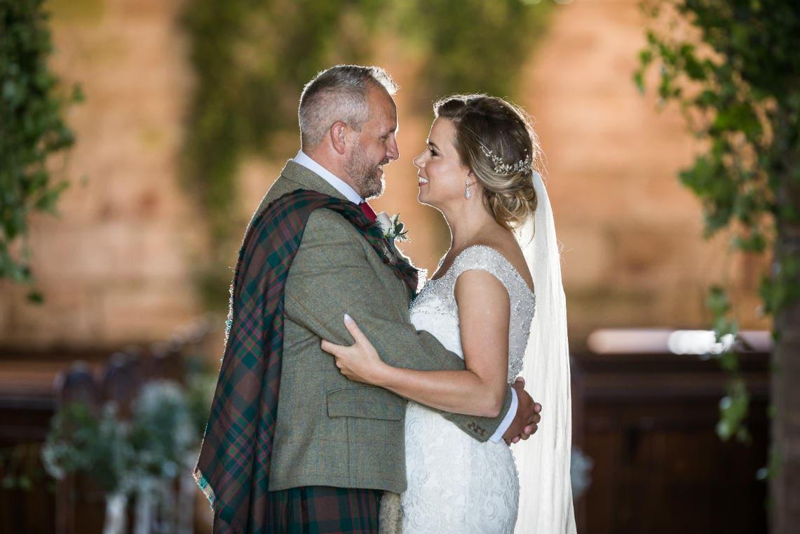 newlyweds Emma and Gary in Dunglass Church