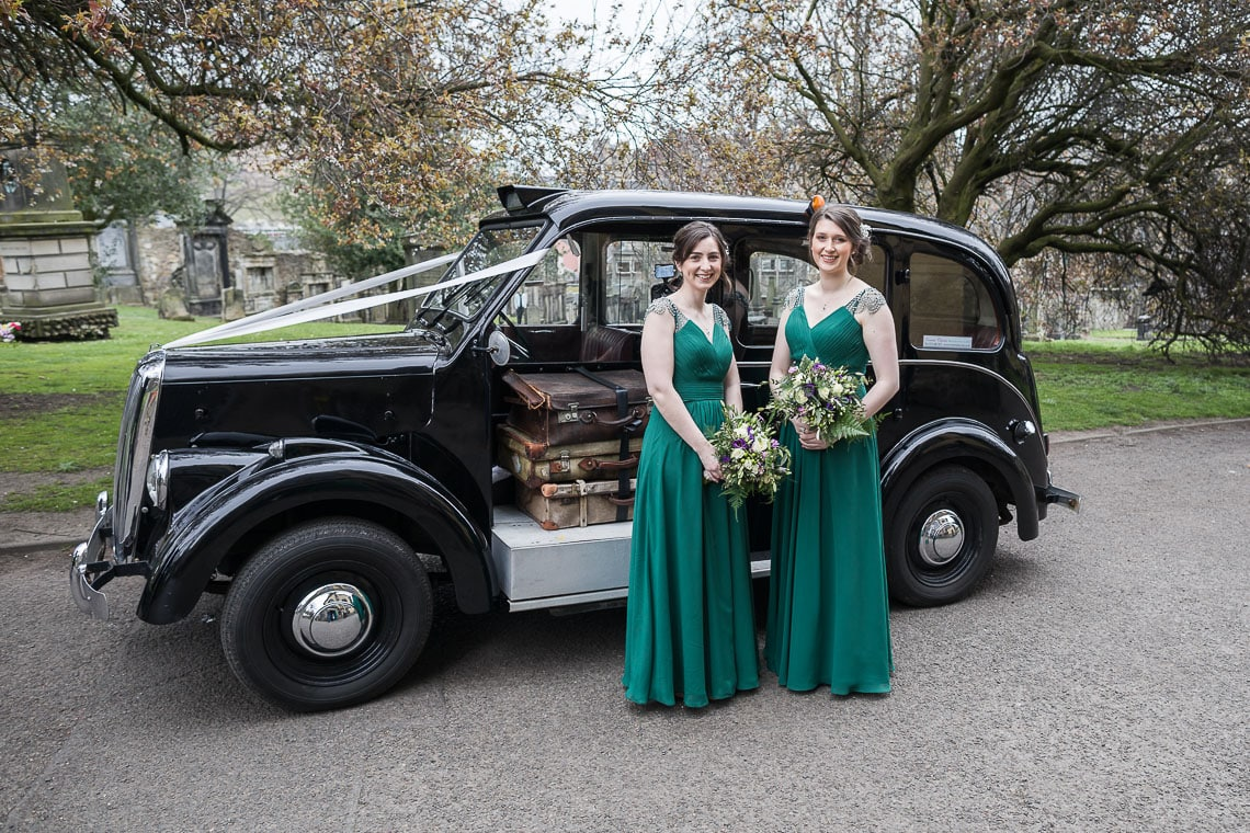 bridesmaids standing beside car old Beardmore Taxi from Ecosse Classic Cars