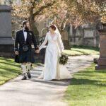 newlyweds holding hands at Greyfriars Kirk graveyard