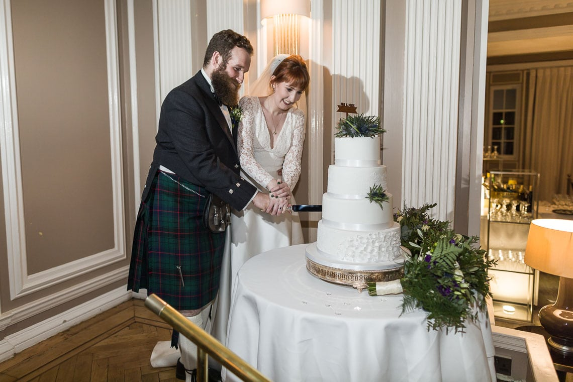 newlyweds cutting their 3D Cakes cake at Waldorf Astoria Edinburgh