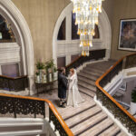 Wedding Photographer Edinburgh Waldorf Astoria The Caledonian - newlyweds on the grand staircase