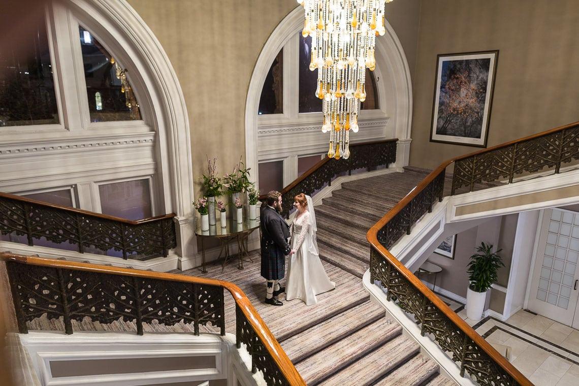 Wedding Photographer Edinburgh Waldorf Astoria The Caledonian - newlyweds on the grand staircase
