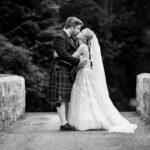 newlyweds kissing in garden