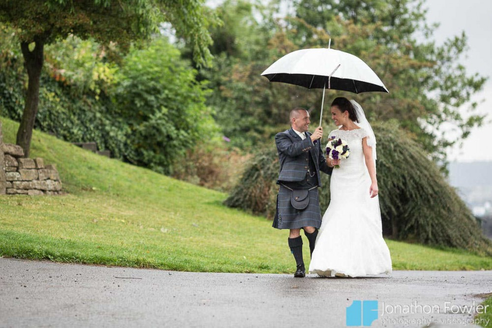 Newly-weds at Calton Hill in the rain