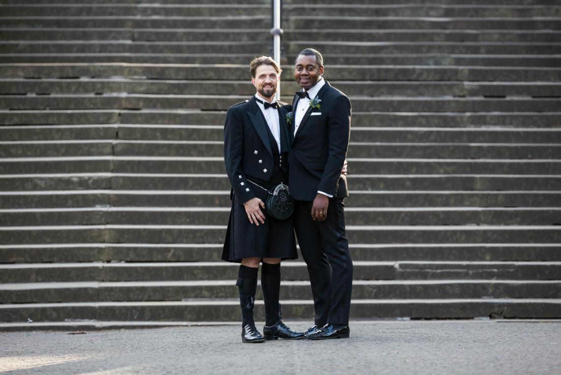 wedding at Waldorf Astoria Edinburgh same-sex newly-weds in Princes Street Gardens